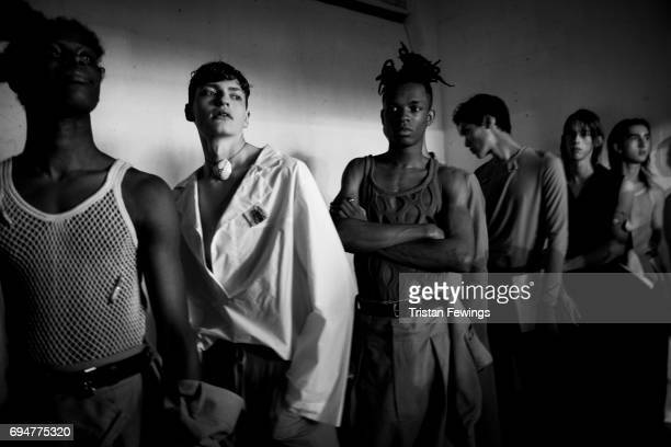 Models backstage ahead of the MAN show during the London Fashion Week Men's June 2017 collections on June 10 2017 in London England