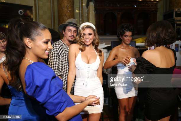 Models backstage ahead of the Oh Polly Fashion Show By Planet Fashion at London Fashion Week at The Royal Horseguards on February 16, 2020 in London,...