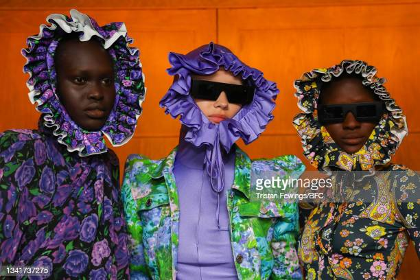Models backstage ahead of the Richard Quinn show during London Fashion Week September 2021 on September 21, 2021 in London, England.
