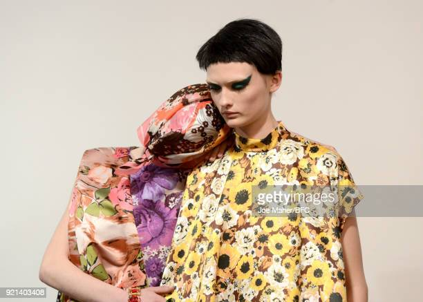 Models backstage ahead of the Richard Quinn show during London Fashion Week February 2018 at BFC Show Space on February 20, 2018 in London, England.