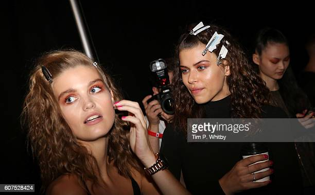 Models backstage ahead of the Topshop Unique runway show during London Fashion Week Spring/Summer collections 2017 on September 18 2016 in London...