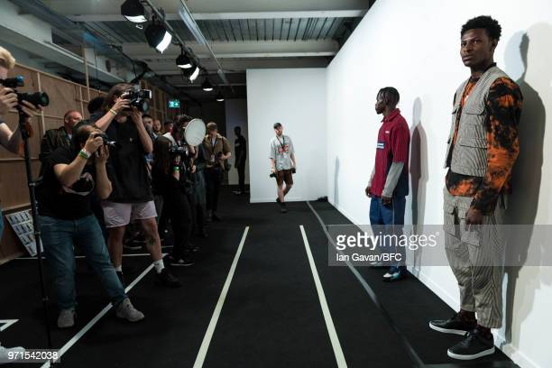 Models backstage ahead of the What We Wear show during London Fashion Week Men's June 2018 at the BFC Show Space on June 11 2018 in London England