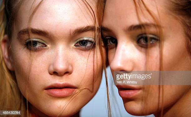 Models backstage at the Ashley Williams show during London Fashion Week Spring Summer 2015 at TopShop Show Space on September 14, 2014 in London,...