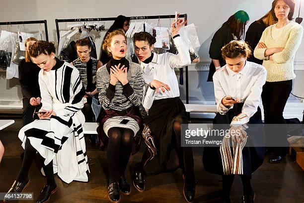 Models backstage at the palmer//harding presentation during London Fashion Week Fall/Winter 2015/16 at ICA on February 22 2015 in London England