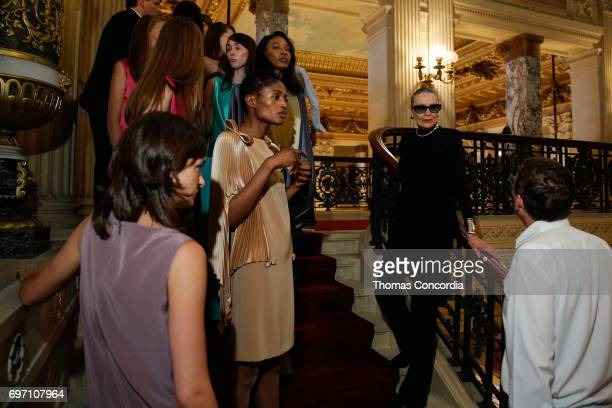 Models backstage with Maryse Gaspard before the Pierre Cardin 70 Years Of Innovation fashion show at The Breakers on June 17 2017 in Newport Rhode...