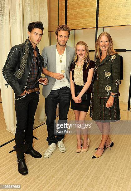 Models Baptiste Giabiconi and Brad Koenig attend the Chanel celebration of Fashion's Night Out at Chanel 57th Street Boutique on September 10 2010 in...