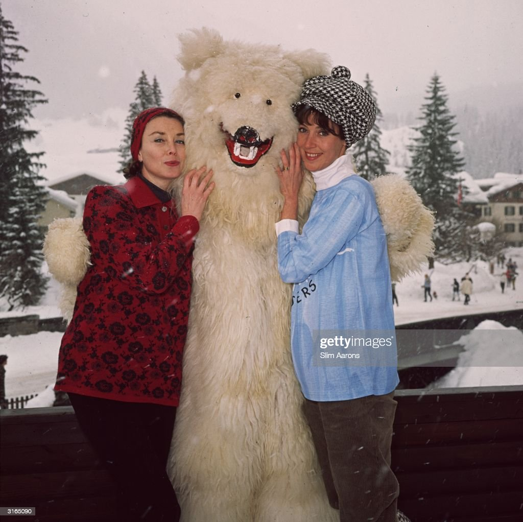 Models Barbara Mullen and Dorian Leigh posing with a friend in a polar bear costume at Klosters ski resort.
