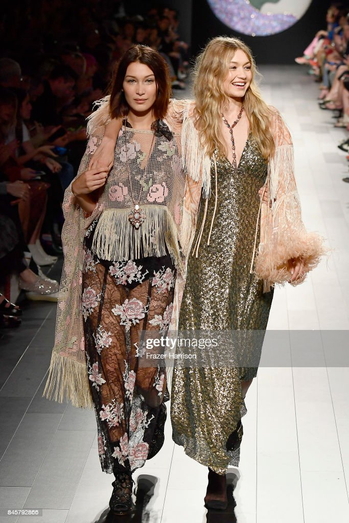 Models Bella Haddid and Gigi Hadid walk the runway for Anna Sui fashion show during New York Fashion Week: The Shows at Gallery 1, Skylight Clarkson Sq on September 11, 2017 in New York City.