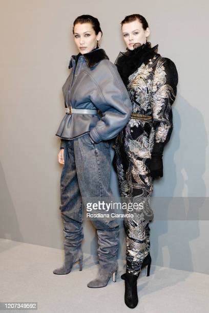Models Bella Hadid and Cara Taylor are seen backstage at the Alberta Ferretti fashion show on February 19, 2020 in Milan, Italy.