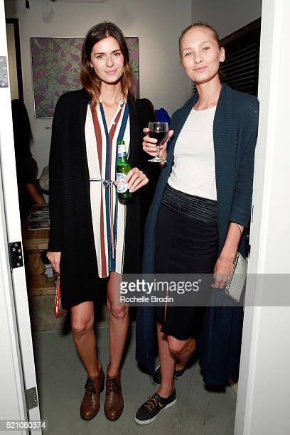 Models Beth Ostendorf and Nadya Panchenko attend the Photo Femmes Exhibition Opening at De Re Gallery featuring the work of Ashley Noelle Bojana...