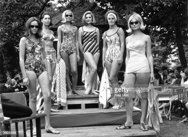Models Betty Rich Audrey Blake Pat Collis Helen Norman Shirley Weston and Susan Holt show off summer swimwear fashions