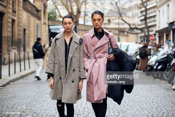 Models BingBing Liu and Yilan Hua after the Elie Saab show during Paris Fashion Week Fall/Winter 2019 on March 02 2019 in Paris France Bingbing wears...