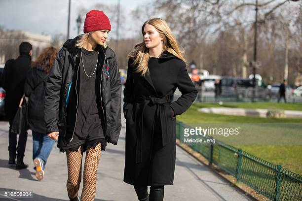 Models Binx Walton and Anna Ewers exit the Chanel show at Grand Palais on March 07, 2016 in Paris, France. Binx wears a red beanie hat with an all...