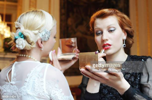 Models Blanche Scofield using a bejewelled compact circa 1945 and Anna Swan using a bejewelled necessaire by Faraone circa 1940 on show as part of...