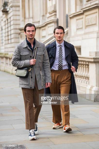 Models Brett Staniland and Scott Staniland wear all Daks with Church's trainers during London Fashion Week February 2020 on February 18 2020 in...