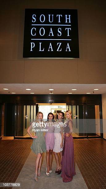 Models Brinna Barnes Colleen Hunter Tiana Zarlin and Rina Roe pose during the Christian Dior Store Opening at South Coast Plaza on September 1 2010...