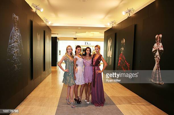 Models Brinna Barnes Tiana Zarlin Colleen Hunter and Rina Roe pose during the Christian Dior Store Opening at South Coast Plaza on September 1 2010...