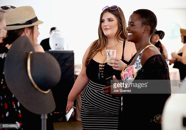 Models Brooke Barrows and Philomena Kwao attend the TORRID #OwnIt Pool Party at The Commune Ace Hotel Palm Springs on April 9 2016 in Palm Springs...