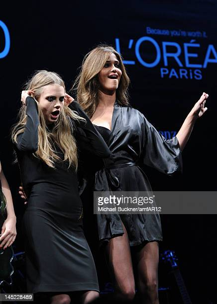 Models Cara Delevingne and Ana Beatriz Barros pose on the catwalk the 2012 amfAR's Cinema Against AIDS during the 65th Annual Cannes Film Festival at...