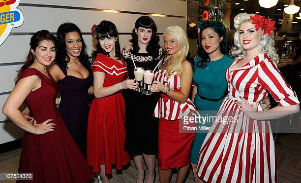 Models Carla Avila Alex Garcia Claire Sinclair Molly Kaiser Holly Madison Crystal Taylor and Doris Mayday appear in Bettie Page style dress at Johnny...