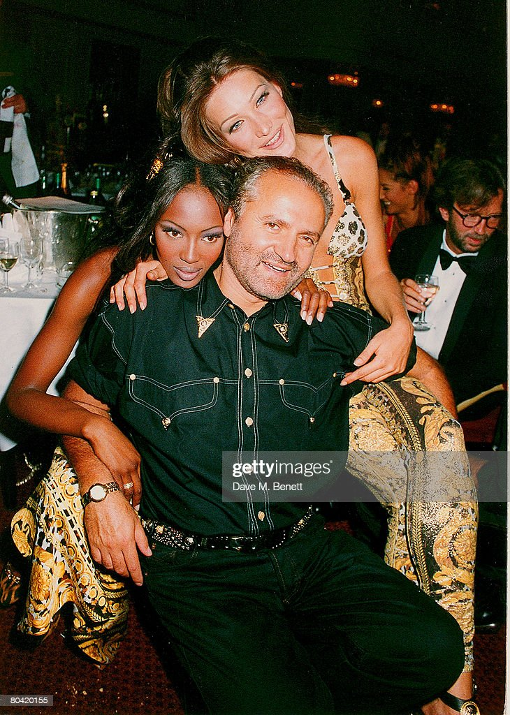 Models Carla Bruni and Naomi Campbell pose with designer Gianni Versace at the Save the Rain Forest Gala dinner at the Grovesnor House Hotel hosted by Sting on March 26, 1992 in London, England.
