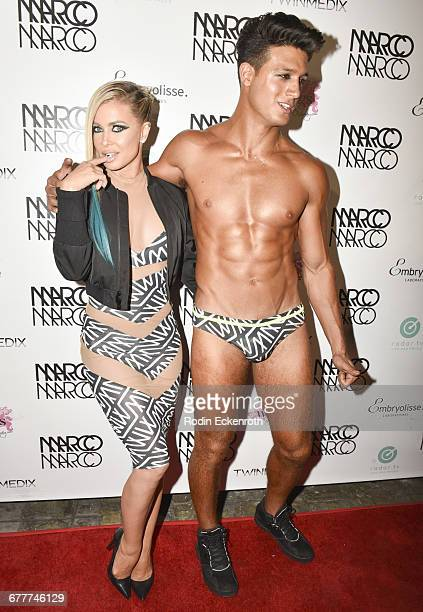 Models Carmen Electra and Asaf Goren attend MARCO MARCO presents 'A Night In The Red Light' Fashion Show at Globe Theatre on October 21 2016 in Los...