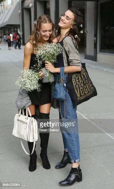 Models Carolina Gonzalez of Spain and Beatrice Brusco of Italy pose after walking in the Spring/Summer 2018 womenswear collection shows during New...