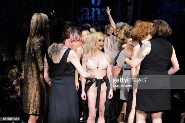 Models celebrate on the runway during AnaOno Intimates X #Cancerland at New York Fashion Week Art Hearts Fashion NYFW FW/17 at The Angel Orensanz...