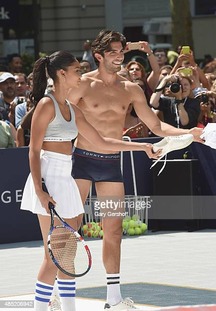Models Chanel Iman and Akin Akman attend the Tommy Hilfiger And Rafael Nadal Launch Global Brand Ambassadorship at Bryant Park on August 25 2015 in...