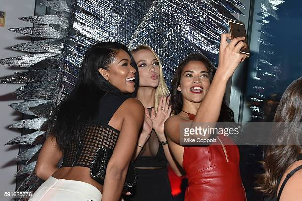 Models Chanel Iman Hannah Ferguson and Shanina Shaik take a selfie during the W Hotel party to celebrate the opening of W Dubai on August 17 2016 in...