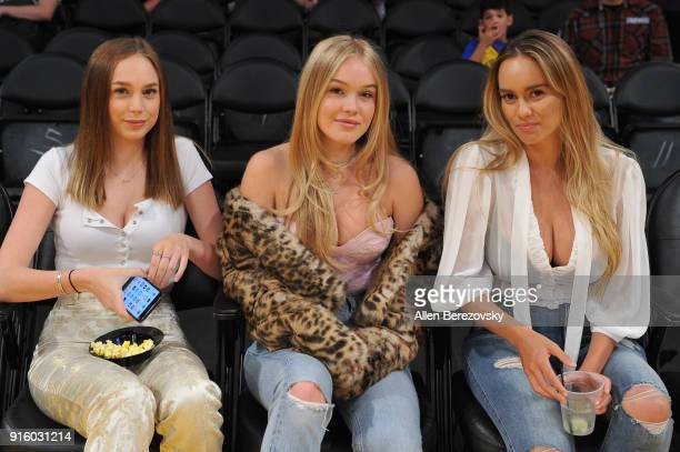 Models Chantal Roe Faith Schroder and France Duque attend a basketball game between the Los Angeles Lakers and the Oklahoma City Thunder at Staples...
