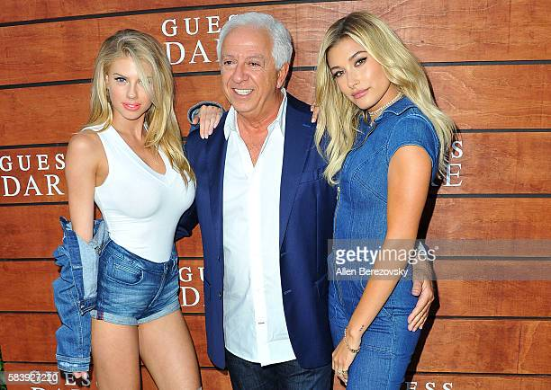 Models Charlotte McKinney Guess CoFounder Paul Marciano and Hailey Baldwin attend GUESS Celebration Launch of Dare Double Dare Fragrance at Ysabel on...