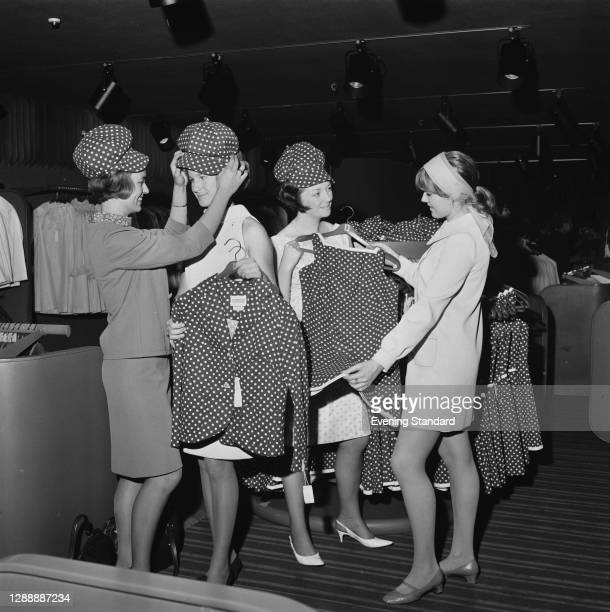 Models Cheryl Perrer, Monique Mulder, Penny Moulder and Loraine Wharry try on clothes at the Harrods Way In boutique at Harrods in London, featuring...