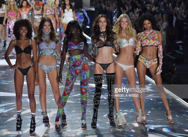 Models Cheyenne Maya Carty Lorena Rae Duckie Thot Barbara Fialho Toni Garrn and Aiden Curtiss walk the runway at the 2018 Victoria's Secret Fashion...