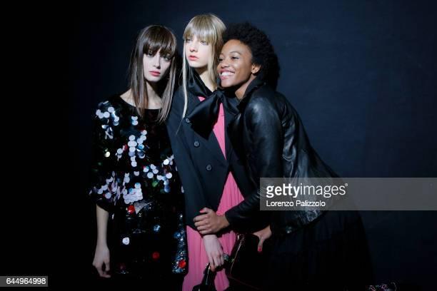 Models Chiara Corridori, Chiara Leone and Diana Sanchez are seen backstage ahead of the Emporio Armani show during Milan Fashion Week Fall/Winter...