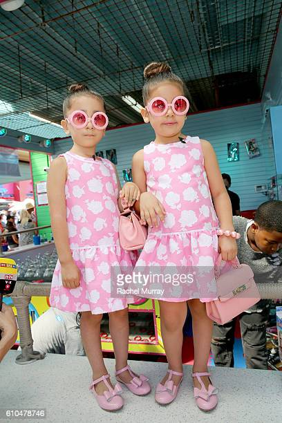 Models Chloe Abir and Bella Abir @theroyaltwins play Ring Toss with guests during the 17th Annual Mattel Party on the Pier on September 25 2016 in...