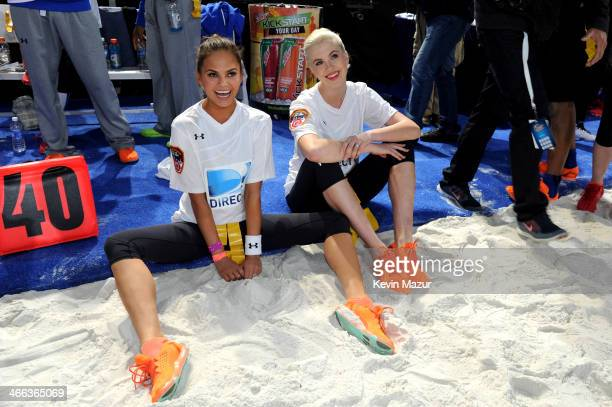 Models Chrissy Teigen and Ireland Baldwin participate in the DirecTV Beach Bowl at Pier 40 on February 1 2014 in New York City