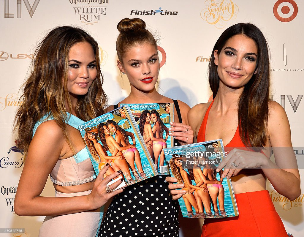 Models Chrissy Teigen, Nina Agdal, and Lily Aldridge attend Club SI Swimsuit at LIV Nightclub hosted by Sports Illustrated at Fontainebleau Miami on February 19, 2014 in Miami Beach, Florida.