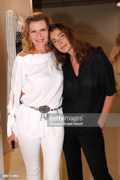 Models Christine Bergstrom and Linda Spierings attend L'Alchimie secrete d'une collection The Secret Alchemy of a Collection Exhibition Preview at...