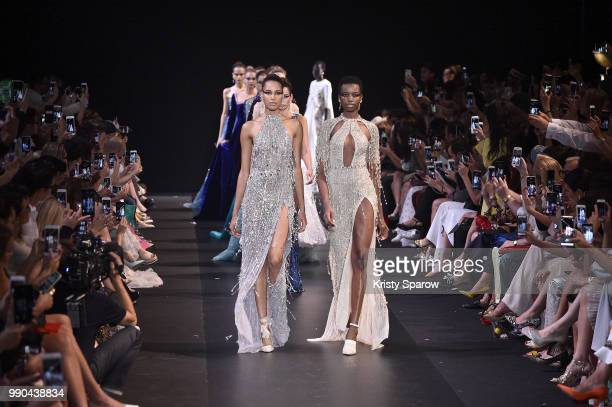 Models Cindy Bruna and Maria Borges lead the finale during the George Hobeika Haute Couture Fall Winter 2018/2019 show as part of Paris Fashion Week...