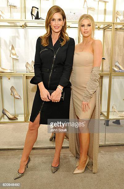 Models Cindy Crawford and Charlotte McKinney attend Jimmy Choo in association with Cindy Crawford and Katharina Harf to host an evening to support...