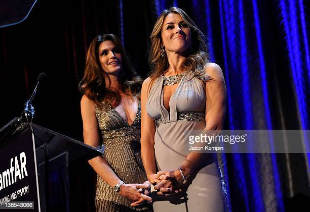 Models Cindy Crawford and Elizabeth Hurley speak onstage during the amfAR New York Gala To Kick Off Fall 2012 Fashion Week Presented By Hublot at...