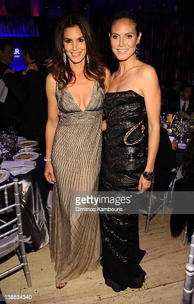 Models Cindy Crawford and Heidi Klum attend the amfAR New York Gala To Kick Off Fall 2012 Fashion Week Presented By Hublot at Cipriani Wall Street on...