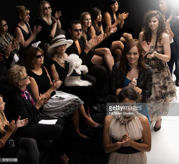 models clapping on runway at fashion show - fashion show stock pictures, royalty-free photos & images