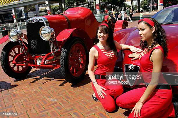 Models Claudia Gutierrez and Melinda Smith pose next to an Alfa Romeo Competizione and a 63 litre straight six Alfa Romeo G1 originally imported new...