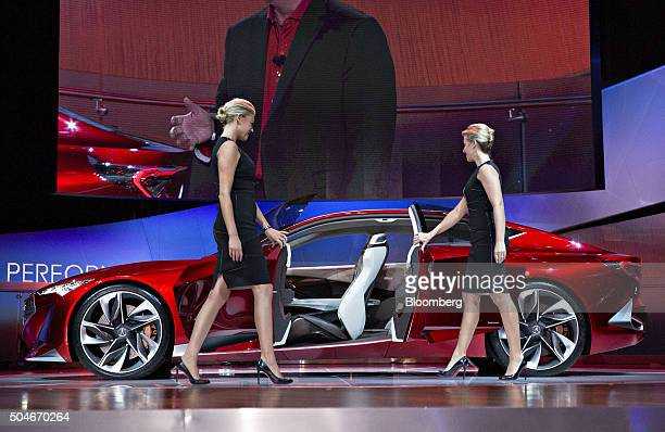 Models close the doors of the Honda Motor Co Acura Precision concept vehicle during the debut at the 2016 North American International Auto Show in...