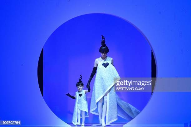 Models Coco Rocha and her daughter Ioni Conran present creations by Jean-Paul Gaultier during the 2018 spring/summer Haute Couture collection fashion...
