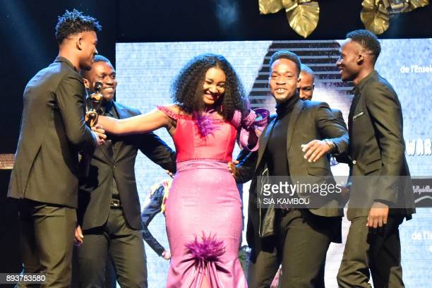 Models congratulate Fatim Sidime after she received an award from Ivory Coast's Education Minister during the 8th African Model Exhibition Awards on...