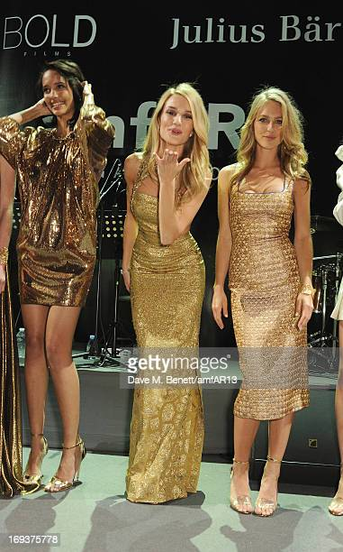 Models Cora Emmanuel Rosie HuntingtonWhiteley and Katharina Damm attend amfAR's 20th Annual Cinema Against AIDS during The 66th Annual Cannes Film...