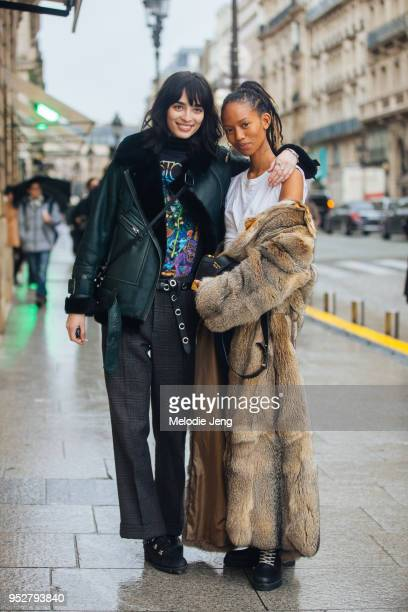 Models Cristina Piccone Adesuwa Aighewi on January 22 2018 in Paris France Cris wears allblack a shearling leather bomber jacket bandtshirt patterned...